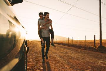 Couple enjoying outdoors on a mud track