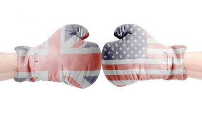 Fototapeta USA and British flags on boxing gloves.USA vs UK concept. obraz