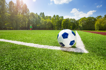 Corner and ball on the field of soccer stadium