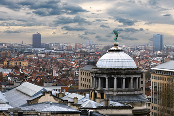 Aerial view of Brussels, Belgium panorama with dramatic clouds at background