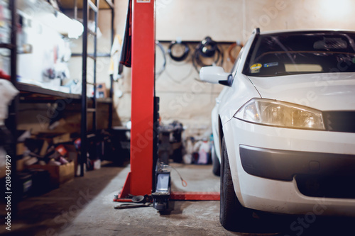 Auto Service Garage With Car At Lift Stock Photo And Royalty Free
