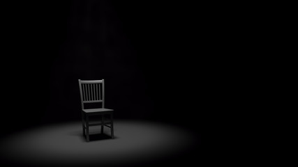 Metal Chair in a Spotlight in a Dark Black Room