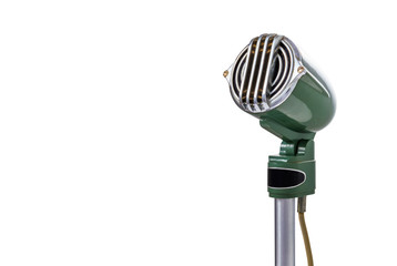 Green vintage microphone on white background