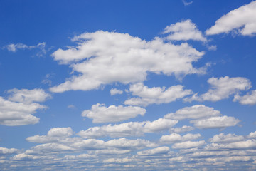 Blue sky with white puffy clouds. Clouds in the blue sky.