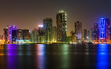 Sharjah waterfront cityscape in UAE at night