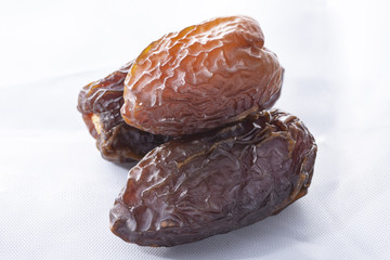 dried dates on a white background