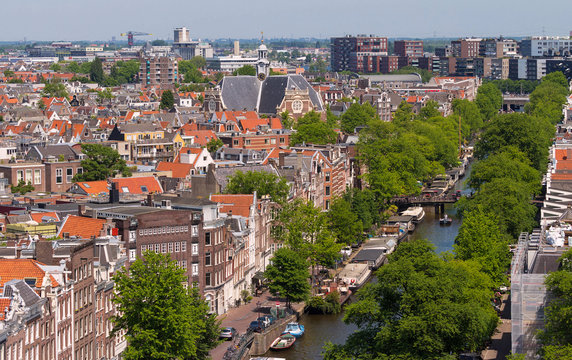 Roofs and facades of Amsterdam. City view from the bell tower of the church Westerkerk, Netherlands.
