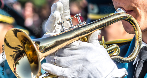 A military brass band-Man plays the trumpet