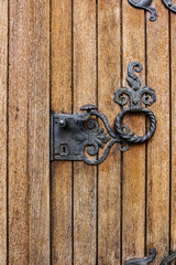 Detail of a side wooden door with iron decoration at St. Stephen's Church, Reuland, Burg-Reuland, Belgium