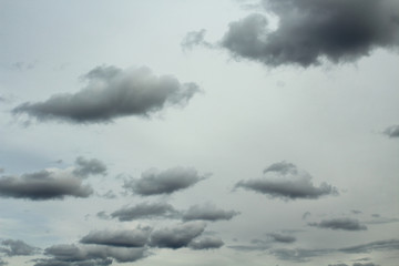 Gray sky and gray dark cumulus clouds. Landscape. Background.
