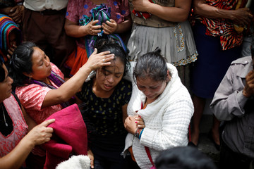 A woman reacts during funerals of Maria Magdalena Zelada and Maritza Nij, who died during the eruption of the Fuego volcano, in Alotenango