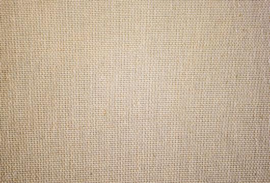 Rough canvas yellow canvas. Texture of coarse cloth, burlap