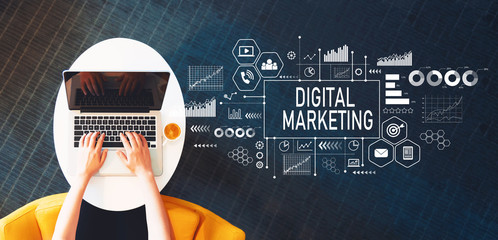 Digital Marketing with person using a laptop on a white table Wall mural