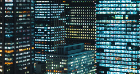 Skyscrapers illuminated at night in Tokyo, Japan
