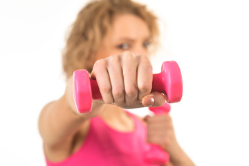 Sport. Fitness woman. Attractive young woman exercising with dumbbells isolated on white background. Gym equipment. Selective focus.