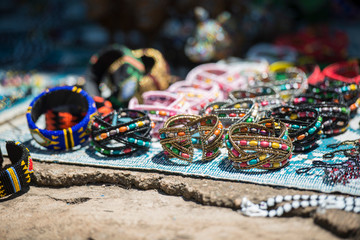 Colorful Beadwork on a cracked stone surface shallow depth of field