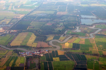 top view field roads and city, aerial photo from plane ,Thailand