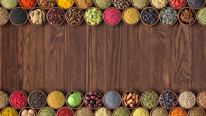 Fototapete - Spices and herbs on table background with empty space for food or recipe