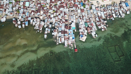 Aerial photo poor water village in Asia. Climate change threatens these coastal slums. Poverty