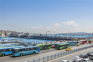 Istanbul, Turkey, 22 June 2006: The Galata Bridge and buses in the Eminonu district of Istanbul.