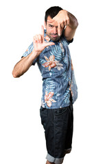 Handsome man with flower shirt focusing with his fingers on isolated white background