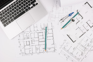 Architecture concept with building plan and laptop