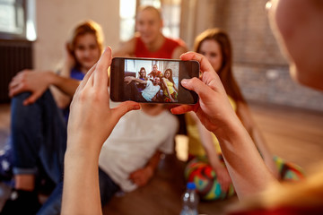 Break dance, freestyle, hip-hop and street dance concept- taking picture of smiling dancer friends