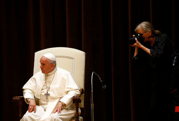American photographer Anna-Lou (Annie) Leibovitz take a picture of Pope Francis during a meeting with children at the Vatican