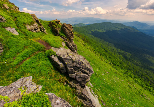 rocky cliffs of the Pikui mountain. Borzhava mountain ridge in the far distance. Beautiful summer landscape on a cloudy day