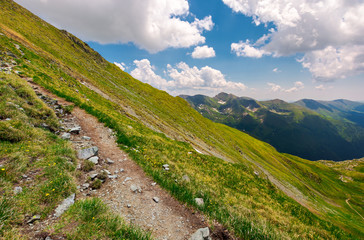 tourist path through grassy slope of Fagaras mount. beautiful summer landscape under the cloudy sky
