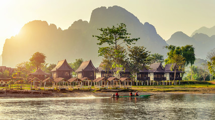 Village and bungalows along Nam Song River in Vang Vieng, Laos.