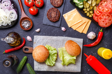 Photo on top of two hamburgers and ingredients