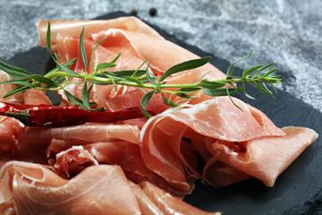 Italian prosciutto crudo or jamon with parsley. Raw ham