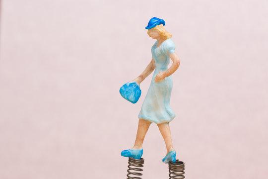 Spring in my step - model figure of woman walking on springs