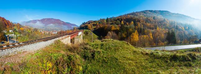 Autumn Carpathian mountains and railroad bridge, Ukraine