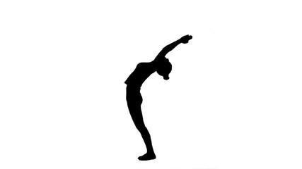 Beautiful woman performing yoga in warrior pose, Virabhadrasana track matte