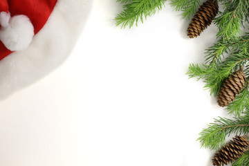 Christmas composition. Christmas frame of fir branches fir cone and Santa hat. Christmas Wallpaper. Flat position, top view