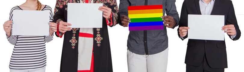 People of different nationalities are holding empty sheets. One of them holds a leaf painted in the color of the LGBT flag. The concept of freedom and human rights