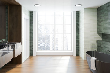 Side view of a white and emerald luxury bathroom