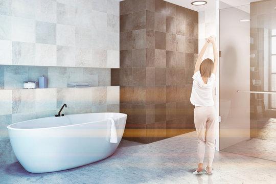 White tiles bathroom interior, side view, woman