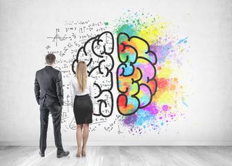 Businessman businesswoman looking at brain sketch