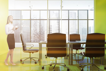 Bright yellow office meeting room interior, woman