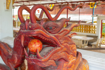 Chinese dragon head made out of wood.