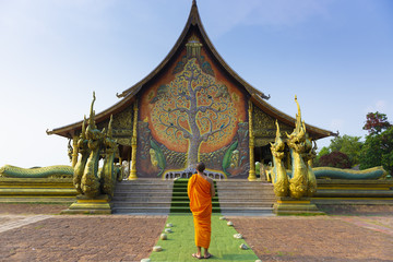 Wall Mural - A buddhist monk is visiting at Sirindhorn Wararam Phu Prao Temple (Wat Phu Prao) in Ubonratchathani, Thailand.