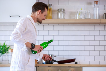 Image of young man cooking food