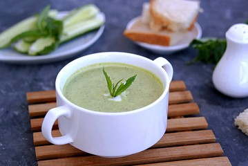 Summer cold yoghurt soup with fresh cucumber, green peas and mint