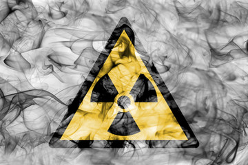 Radioactive substances or ionising radiation hazard warning smoke sign. Triangular warning hazard sign, smoke background.