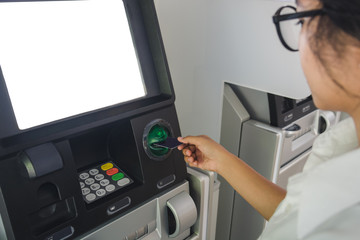 Close-up Of Person Using Credit Card To Withdraw Money From Atm Machine
