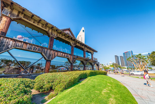 SAN DIEGO - JULY 30, 2017: San Diego skyline and buildings along sea promenade. The city attracts 10 million tourists annually