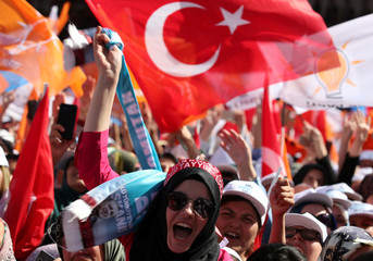 Supporters of Turkish President Tayyip Erdogan react during an election rally in Ankara